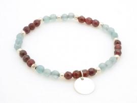Bracelet perles à facettes et médaille en argent